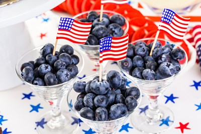 Bowls of blueberries with patriotic decorations