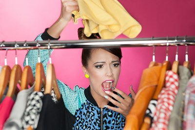 Girl panicking as she cleans out her closet