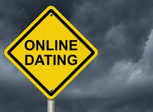 a warning street sign that says online dating