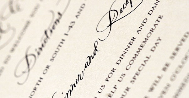 Close up of a wedding invitation that followed etiquette