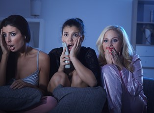 Three girls hearing scary roommate stories